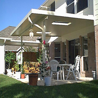 photo of solid, insulated, studio-style patio cover w/ skylights.