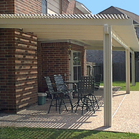 photo of lattice-style patio/shad cover w/ aggregrate patio