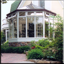 Image of Victorian Conservatory with Bronze roof, stone kneewal.